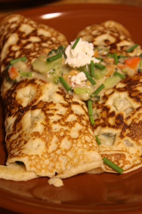 crepes stuffed with veggies in goat cheese cream sauce